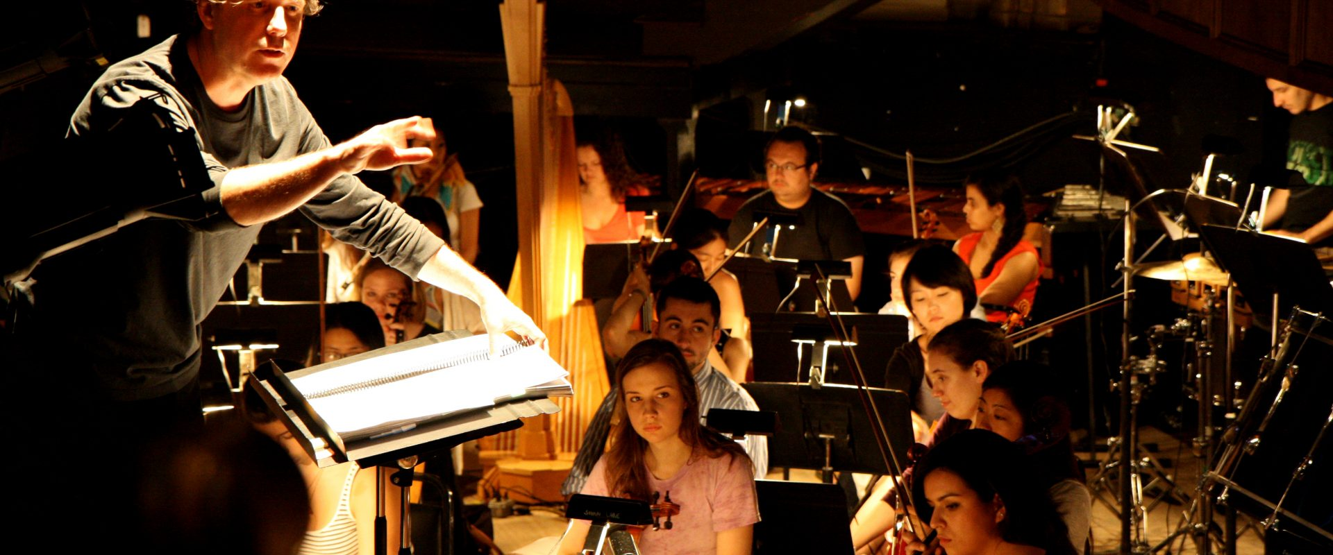 The orchestra, with conductor John Kennedy.